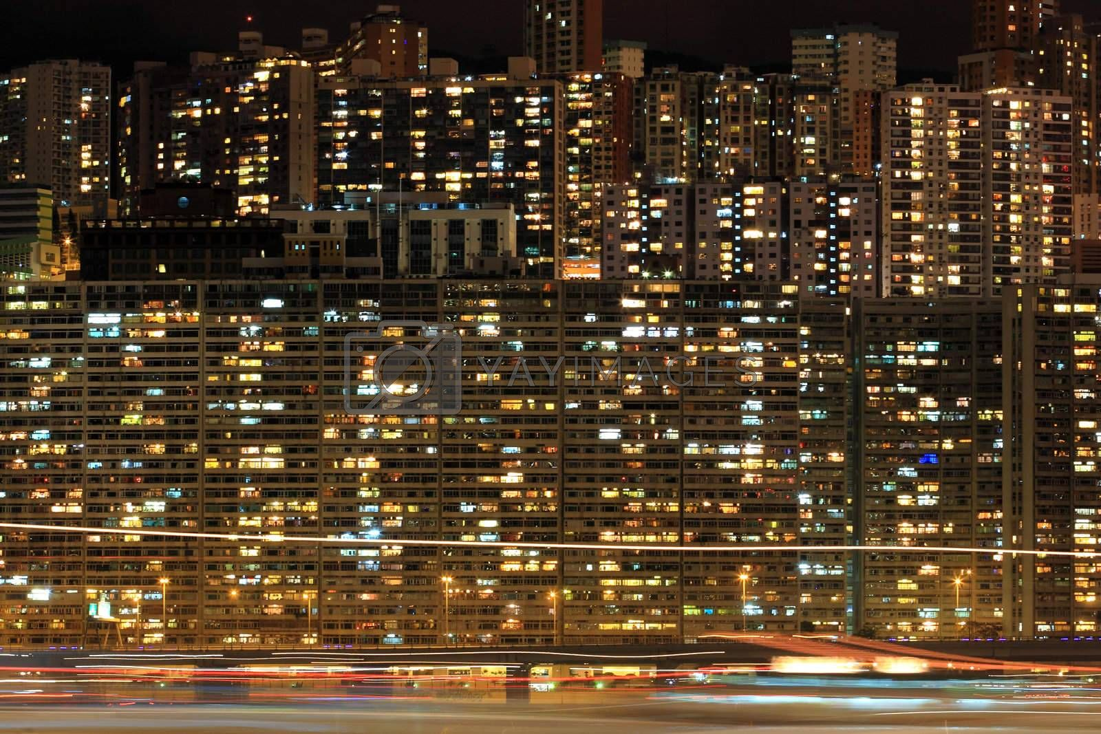 Royalty free image of Apartment block at night, Hong, Kong by leungchopan