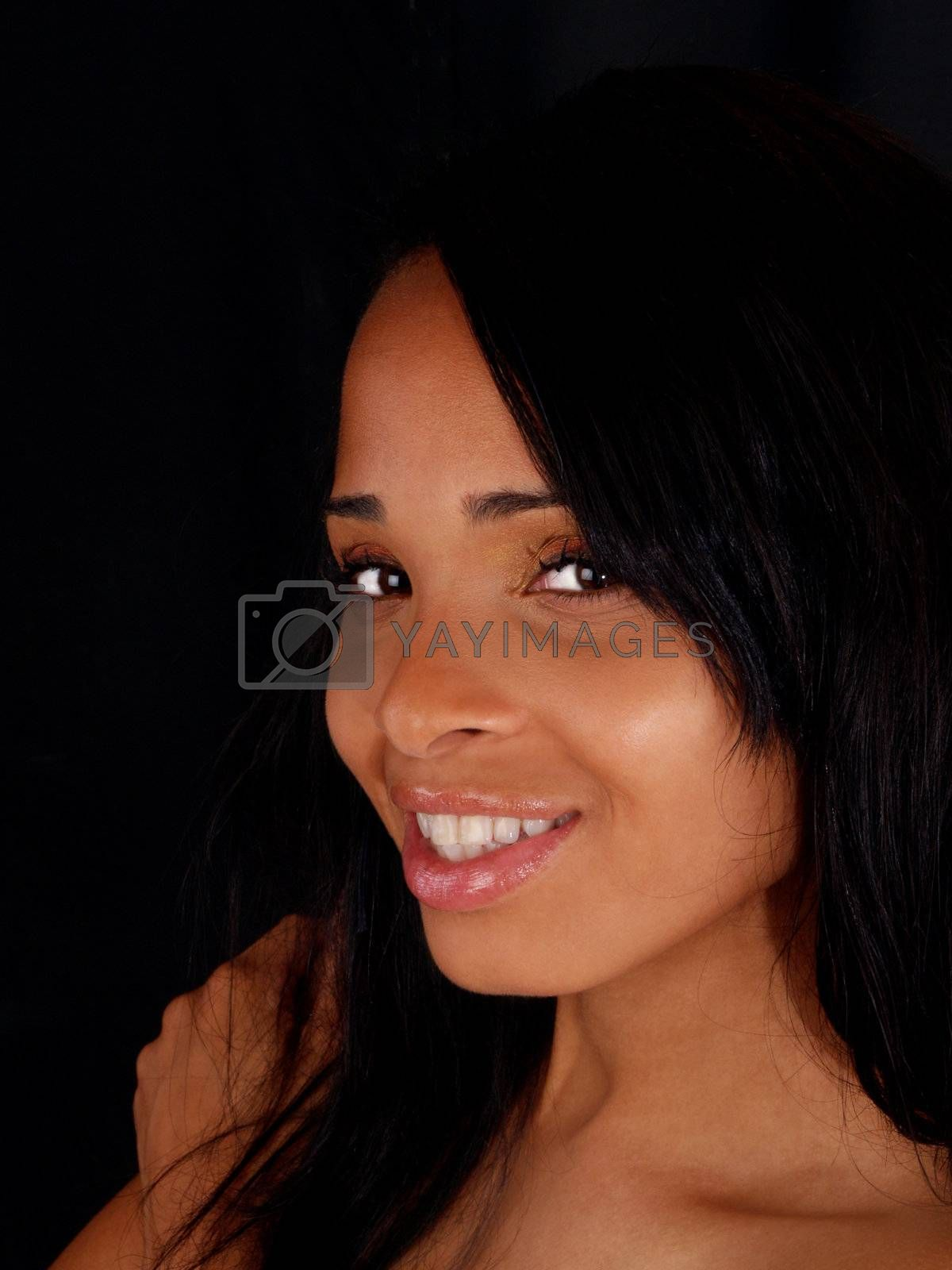 Portrait of smiling pretty young black woman