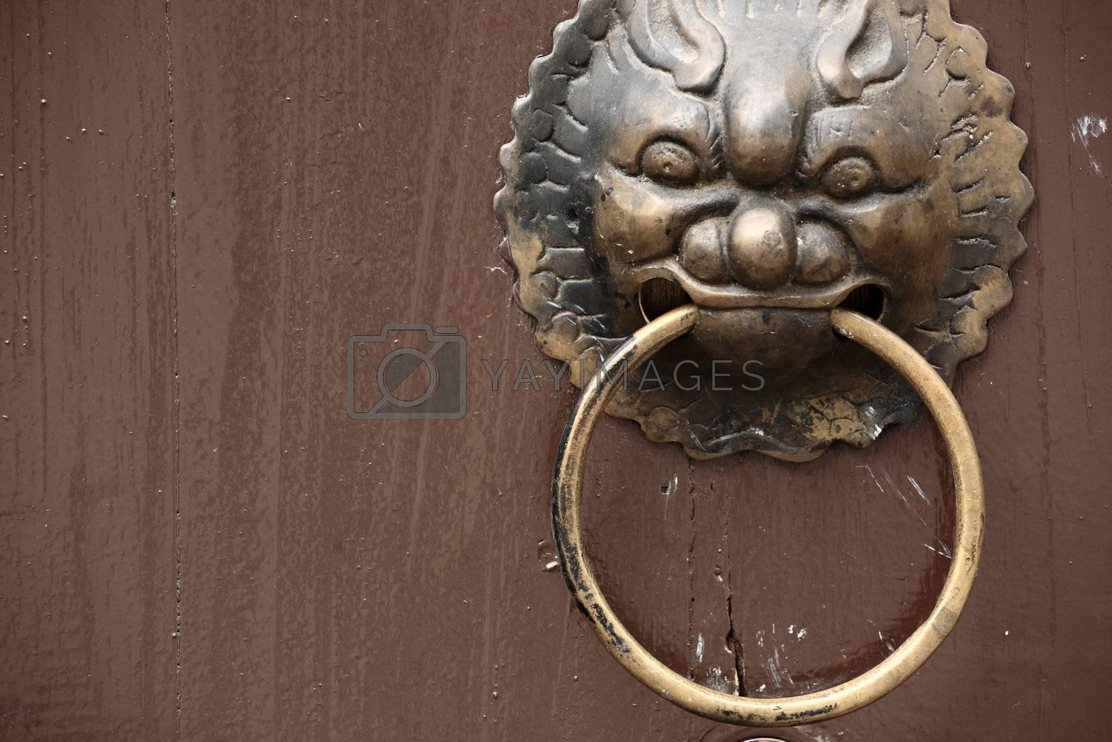 Royalty free image of antique oriental door knocker by leungchopan