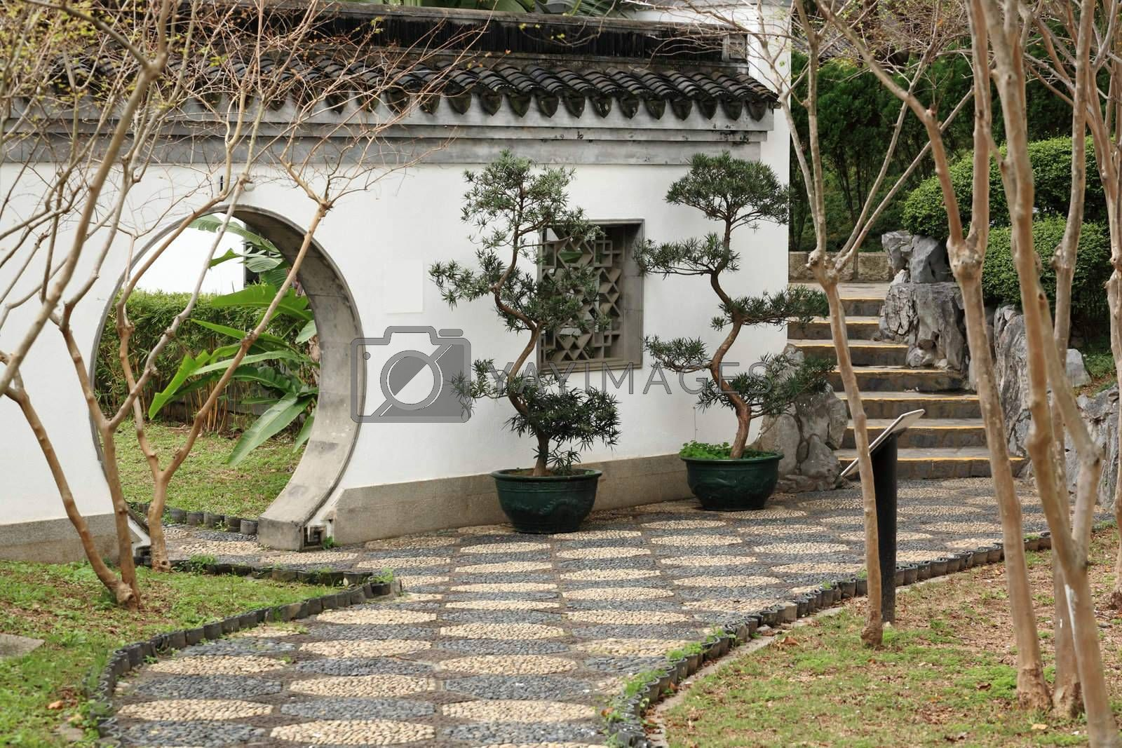 Royalty free image of path in chinese garden by leungchopan