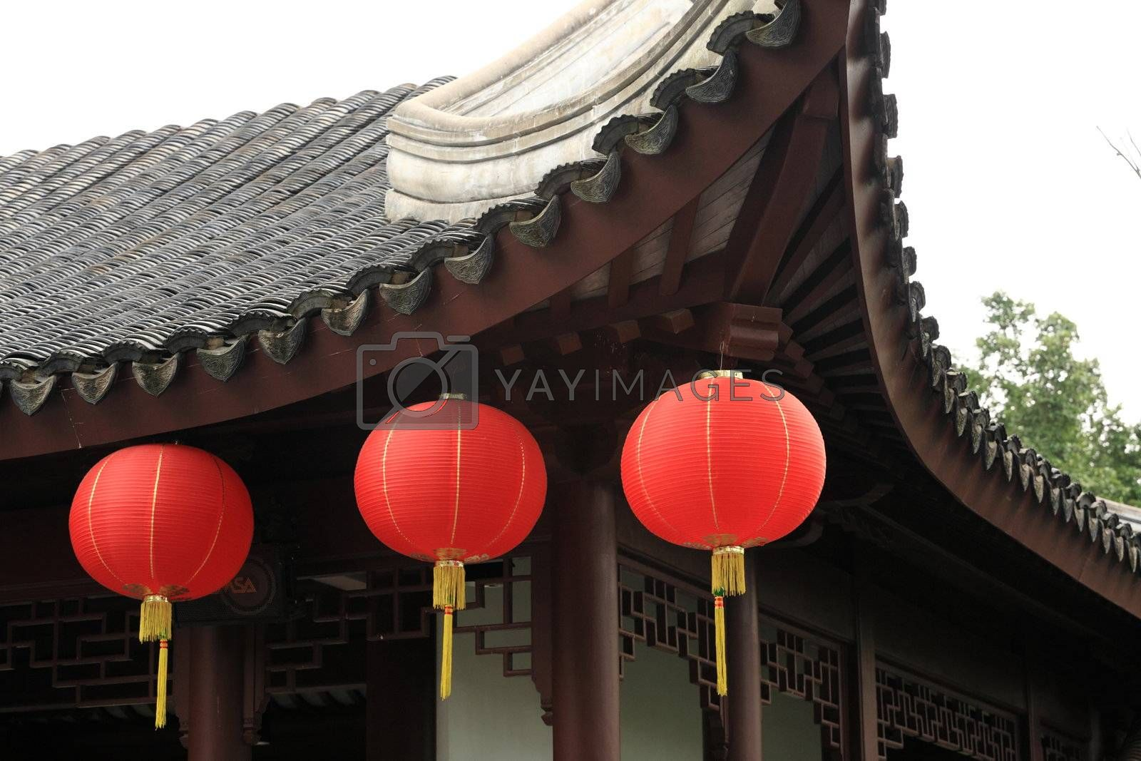 Royalty free image of three lantern under roof by leungchopan