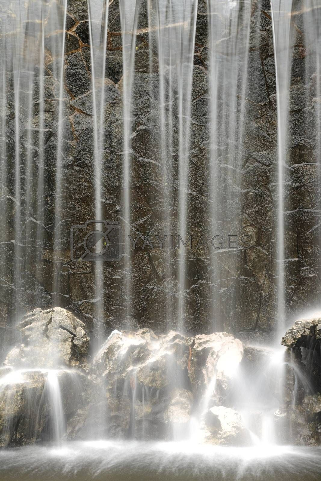 Royalty free image of Artificial waterfall background by leungchopan