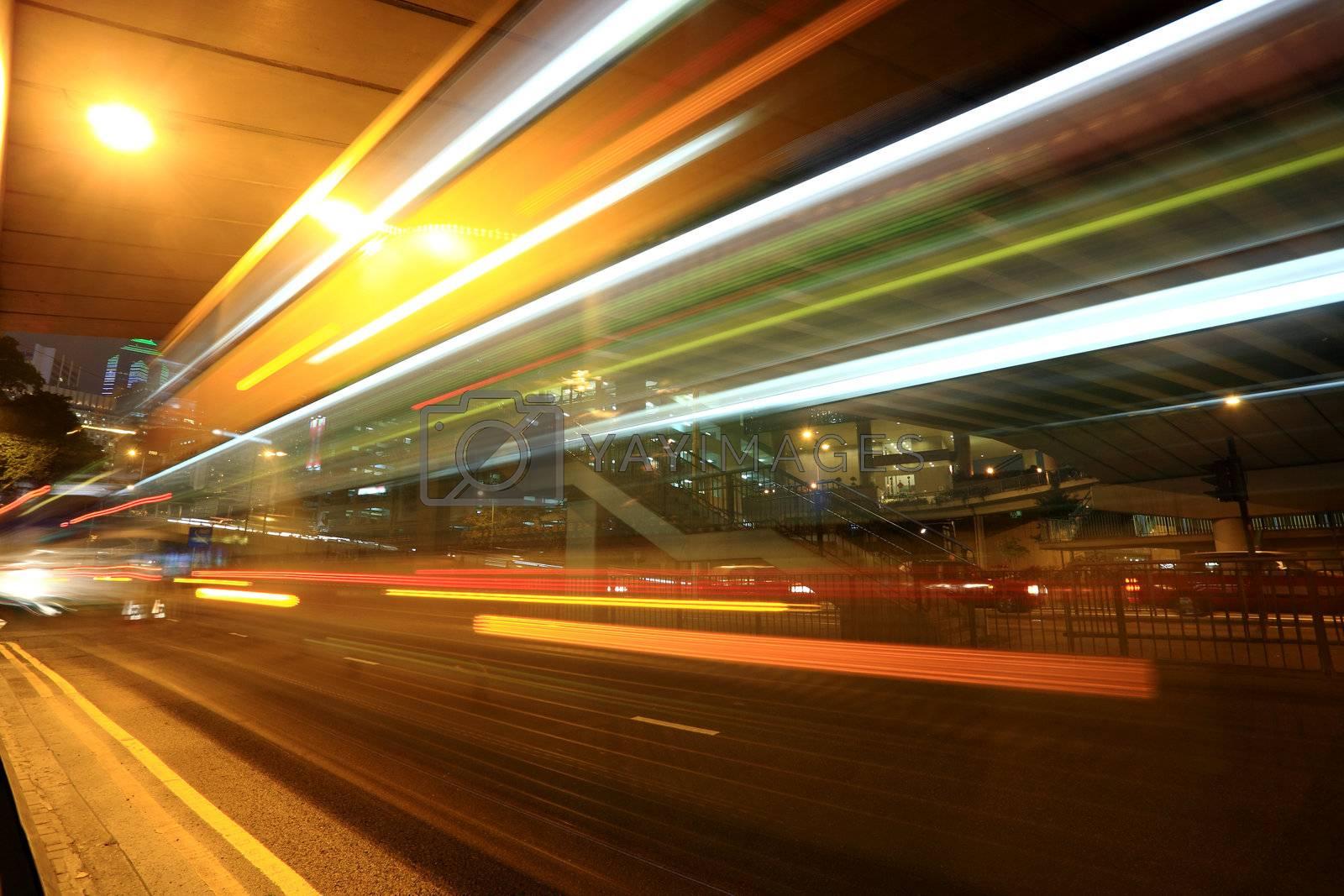 Royalty free image of fast moving bus at night in Hong Kong by leungchopan