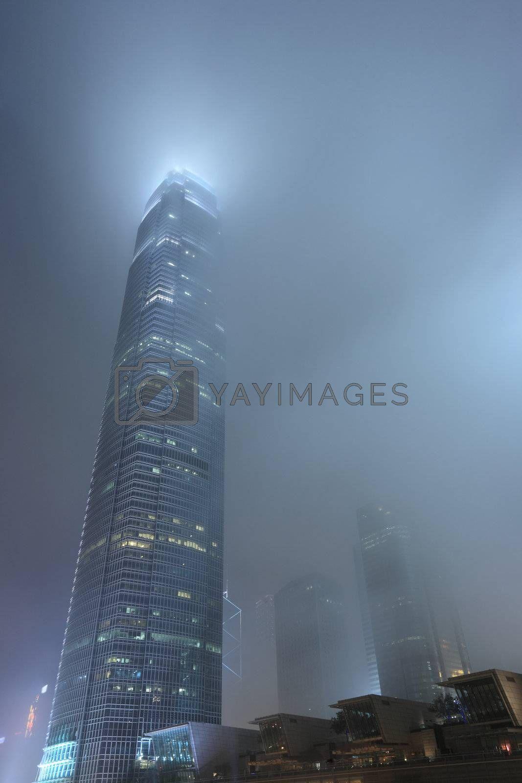 Royalty free image of skyscraper in mist at Hong Kong by leungchopan