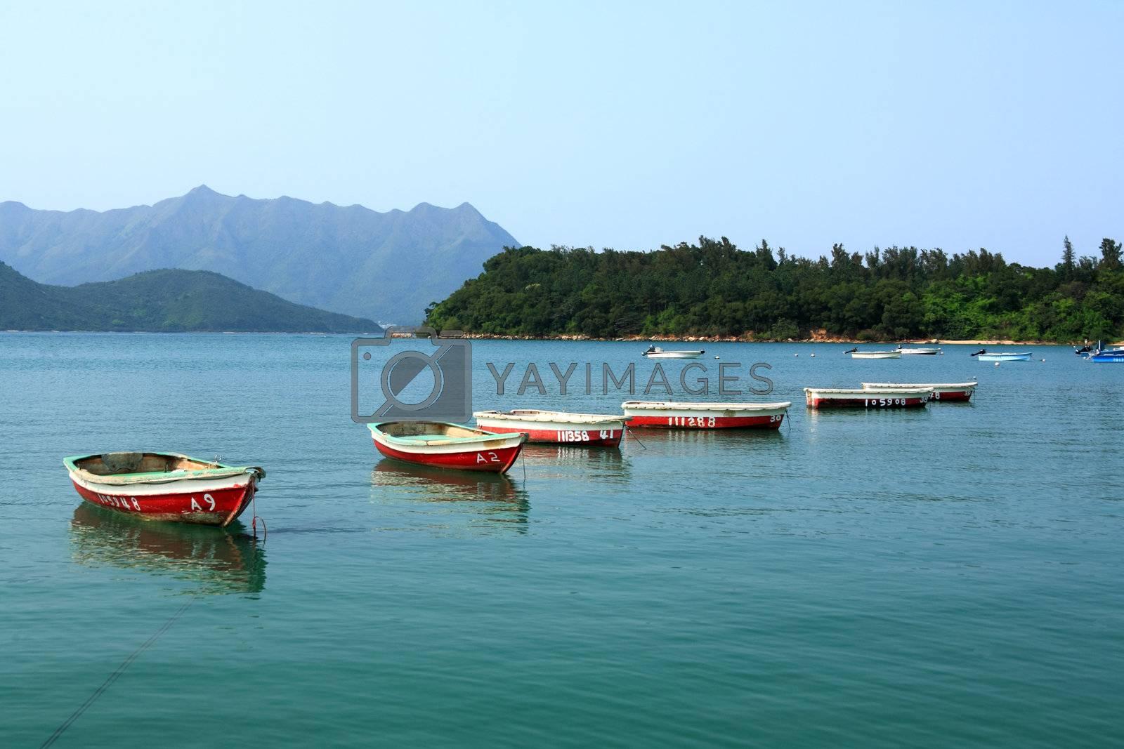 Royalty free image of boats on lake by leungchopan