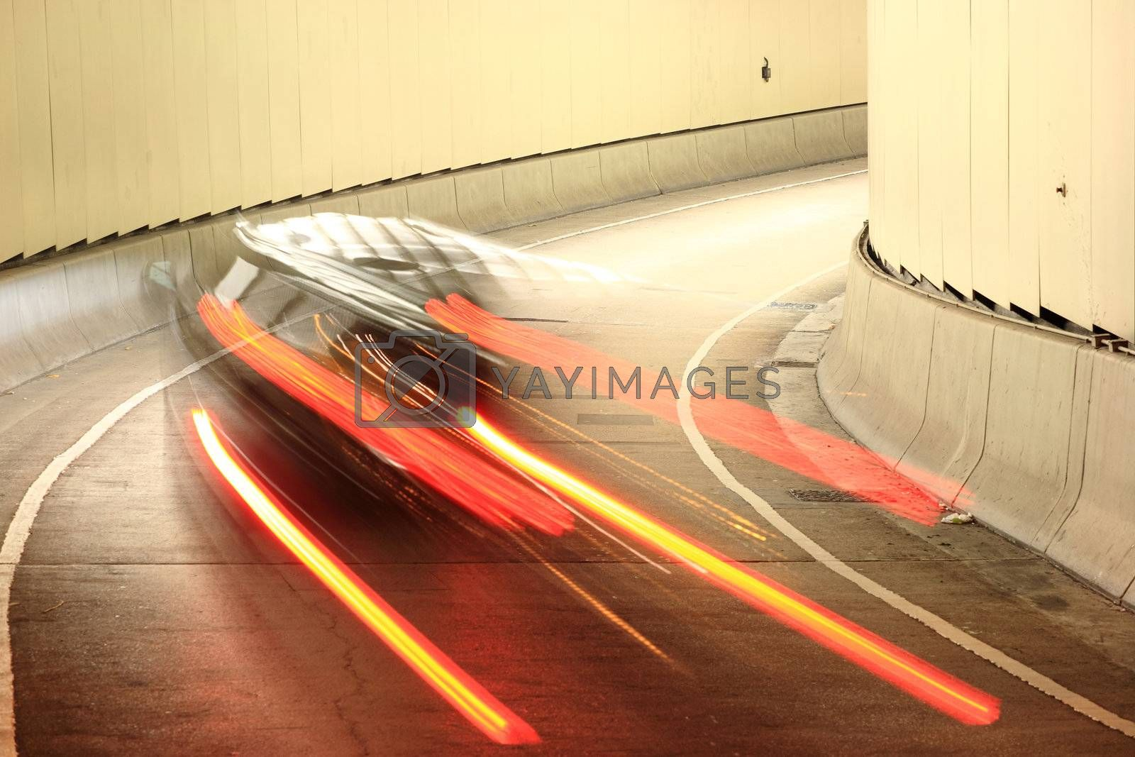 Royalty free image of car going into tunnel by leungchopan