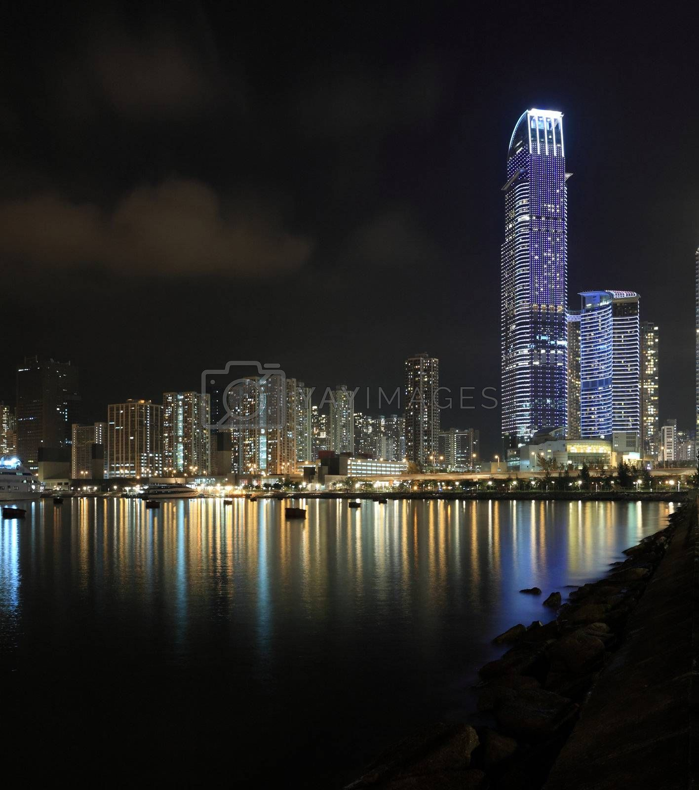 Royalty free image of Business Towers and Residential Apartment Buildings in Hong Kong at night by leungchopan