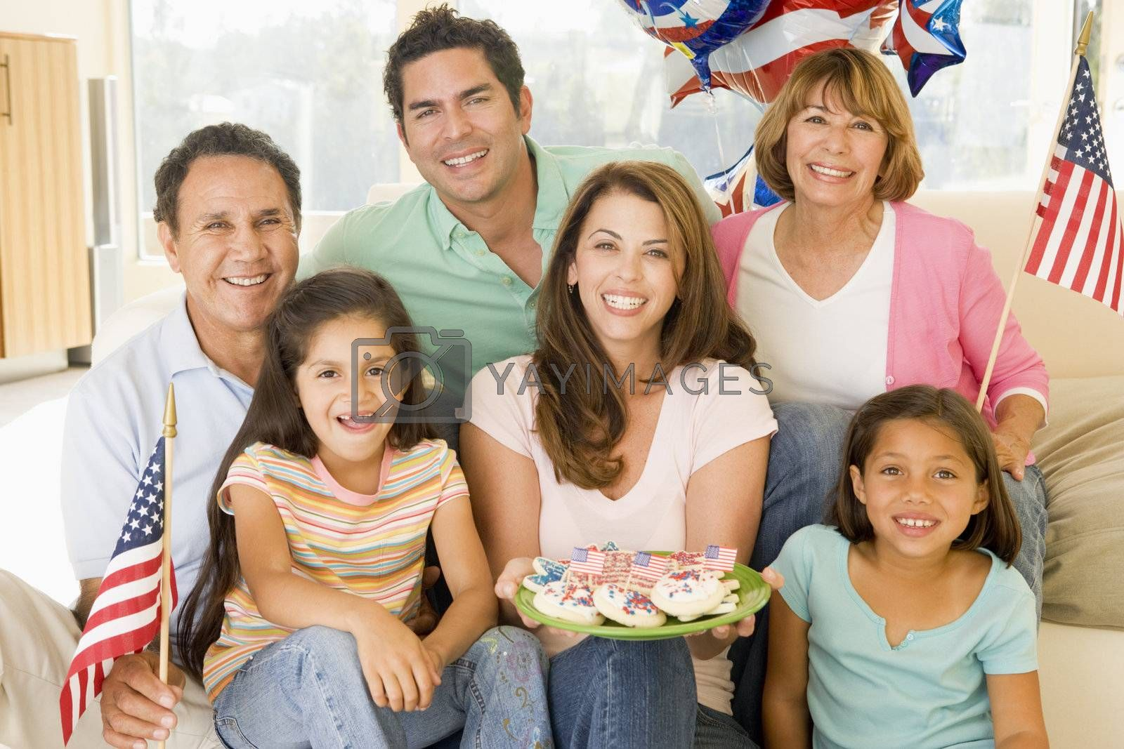 Family in living room on fourth of July with flags and cookies
