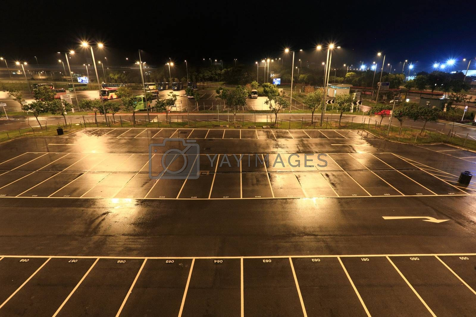 Royalty free image of car park in raining day by leungchopan