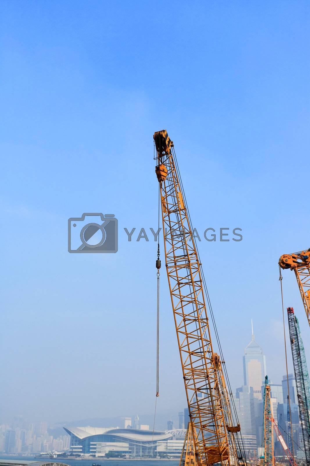 crane arm against a city background by leungchopan