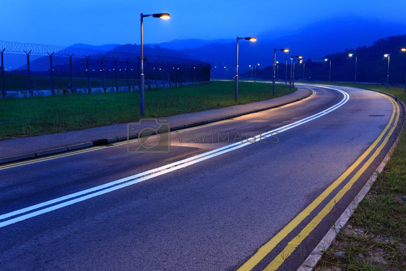 Royalty free image of road at night by leungchopan