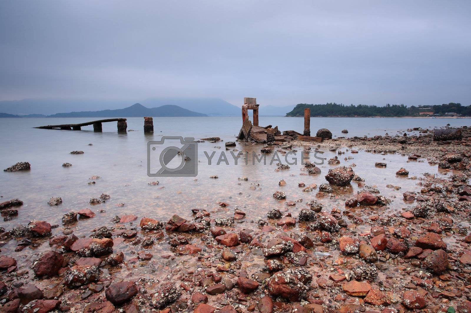 Royalty free image of a desolate and broken peer by leungchopan