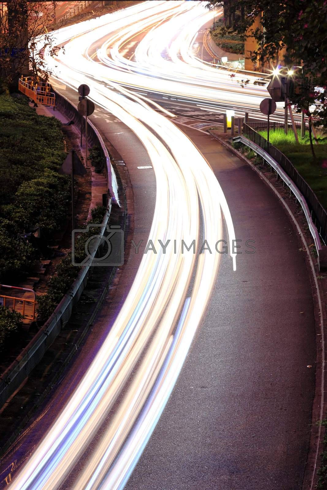 Royalty free image of traffic in downtown by leungchopan