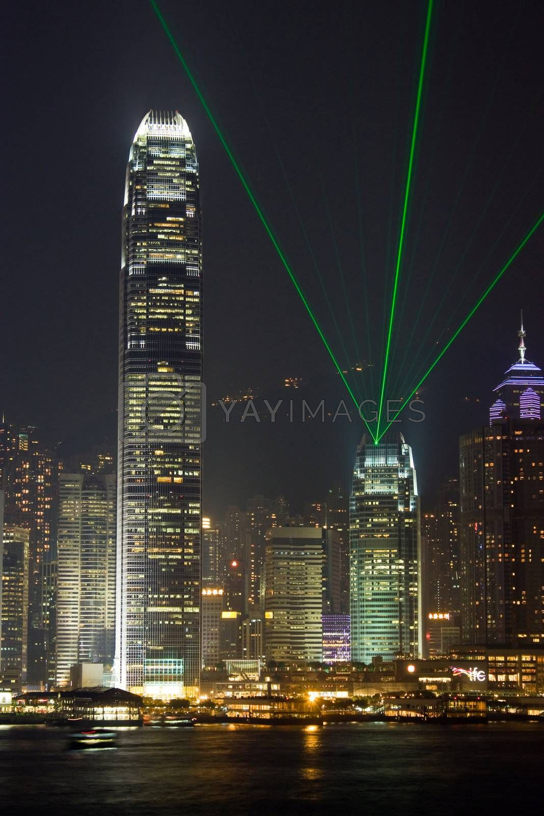 Royalty free image of Hong Kong International Finance Center With Laser by leungchopan