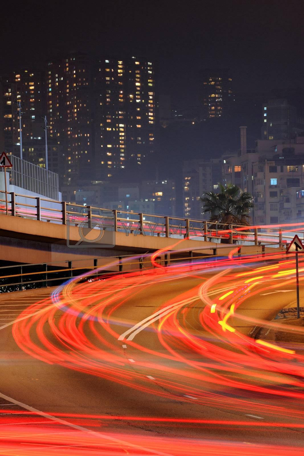 Royalty free image of traffic through downtown in Hong kong by leungchopan
