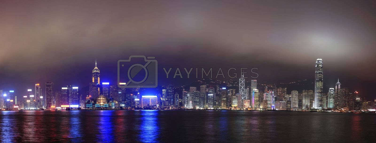 Royalty free image of Panorama of the skyline of Hong Kong at night, with mist by leungchopan