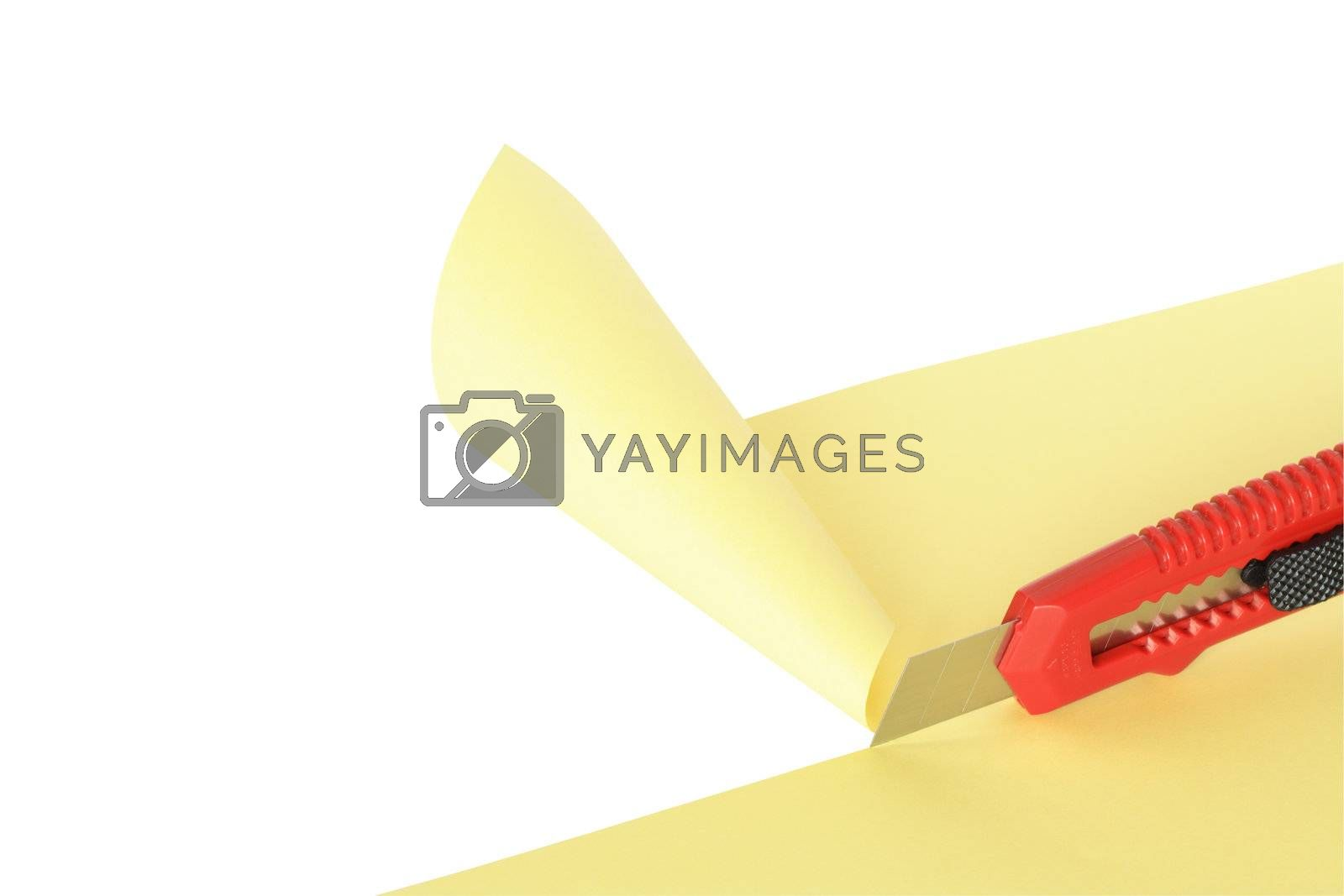 Royalty free image of Knife Cutting Paper by kvkirillov