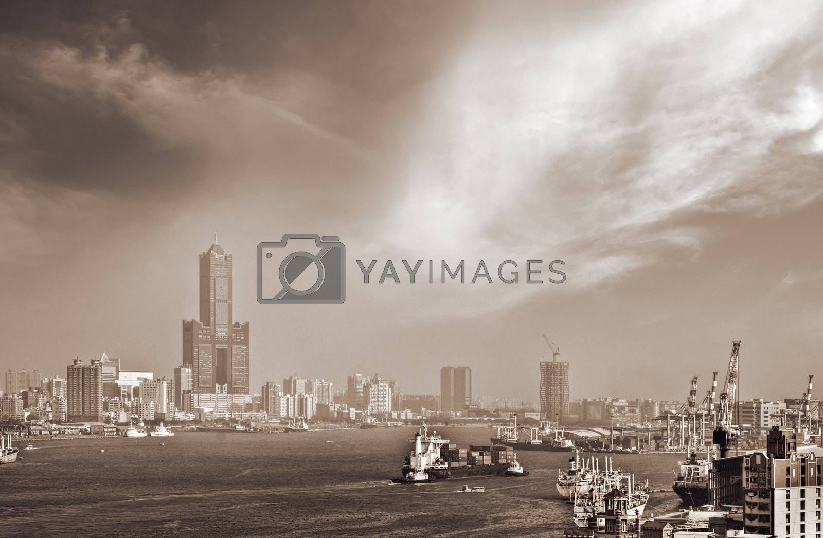 Royalty free image of Boats in harbour and building skyline by elwynn