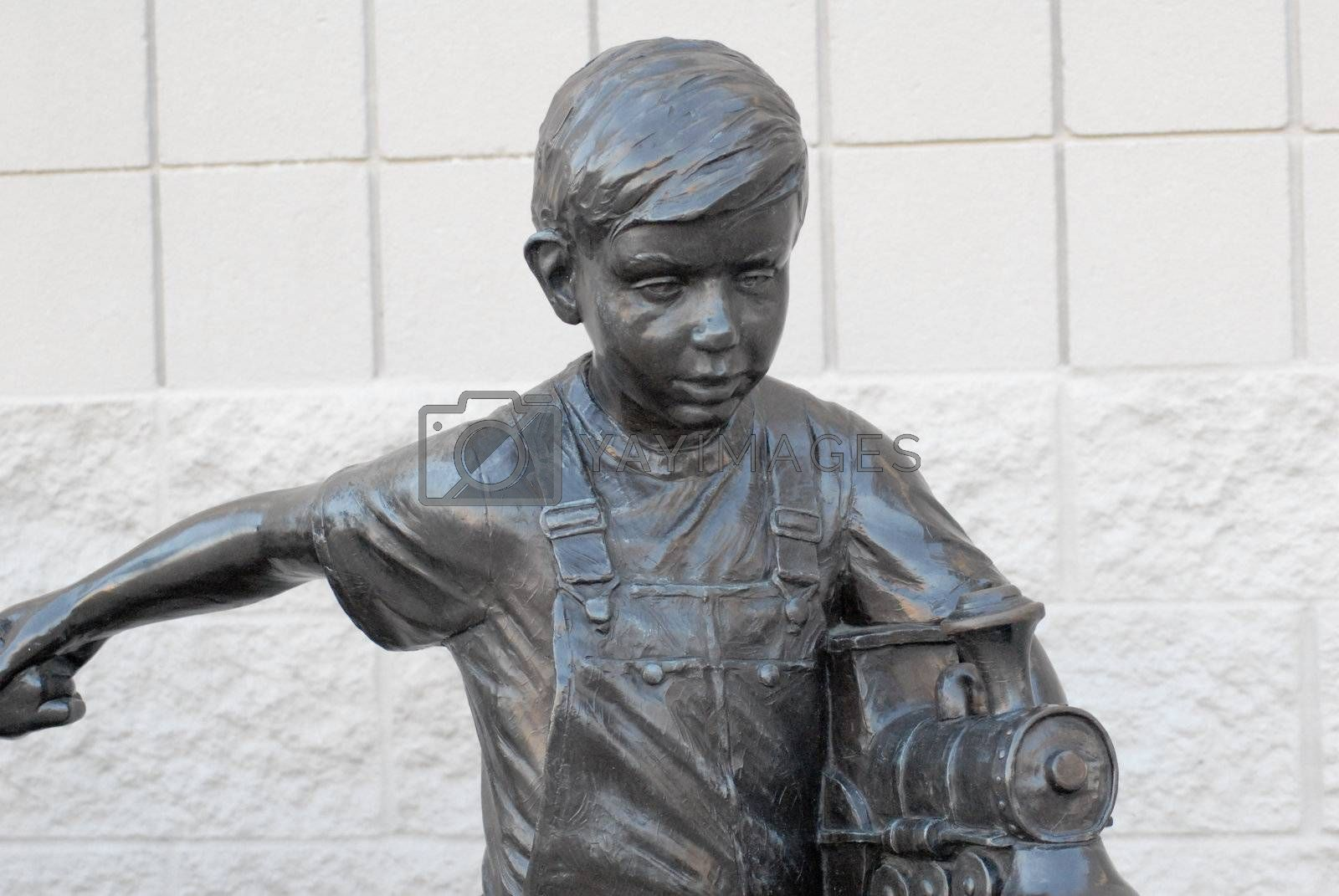 Royalty free image of Bronze Boy Playing With Train by RefocusPhoto