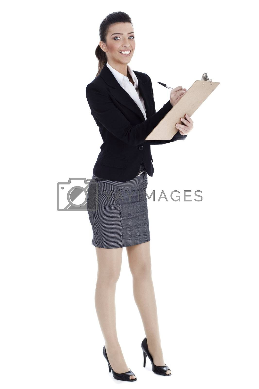 Royalty free image of Full length of business woman writing in pad by get4net