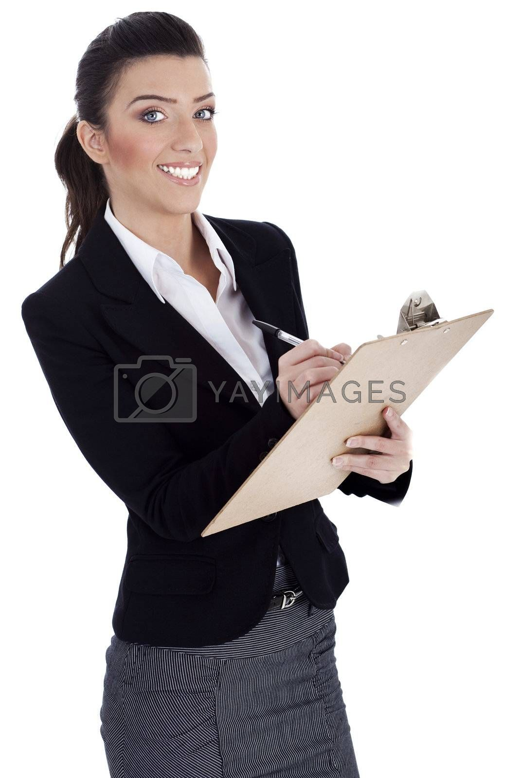 Royalty free image of Business professional writes on pad by get4net
