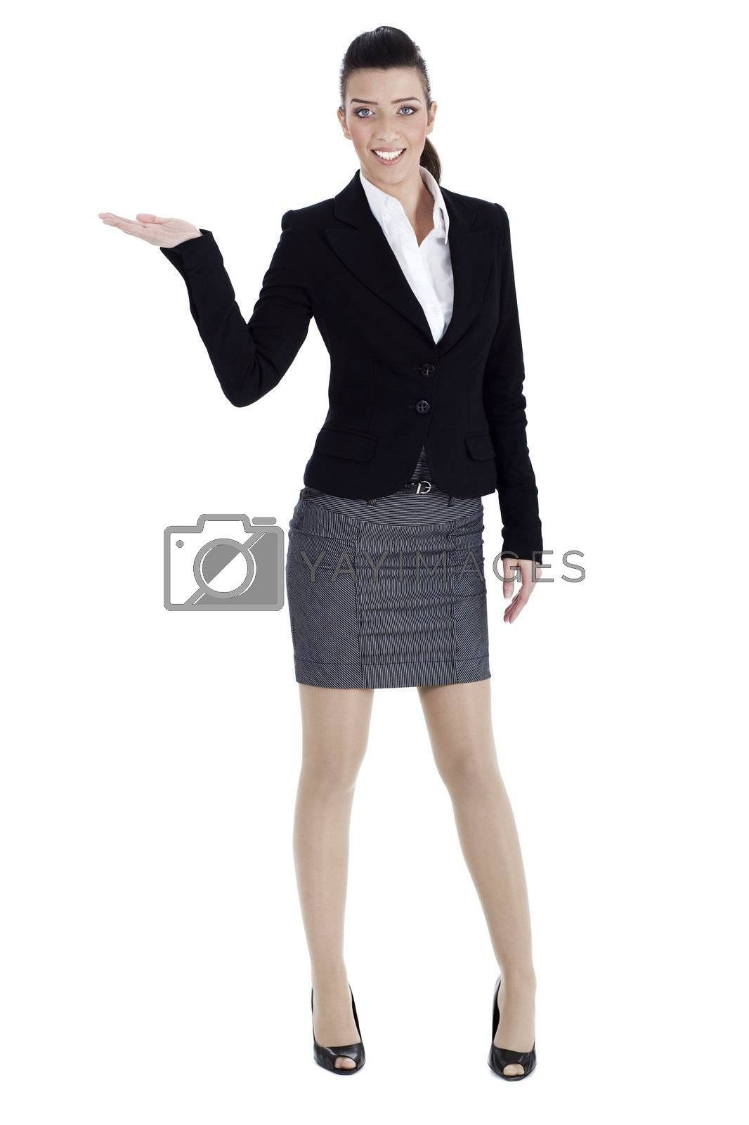 Royalty free image of Full length of young woman pointing copysapce by get4net