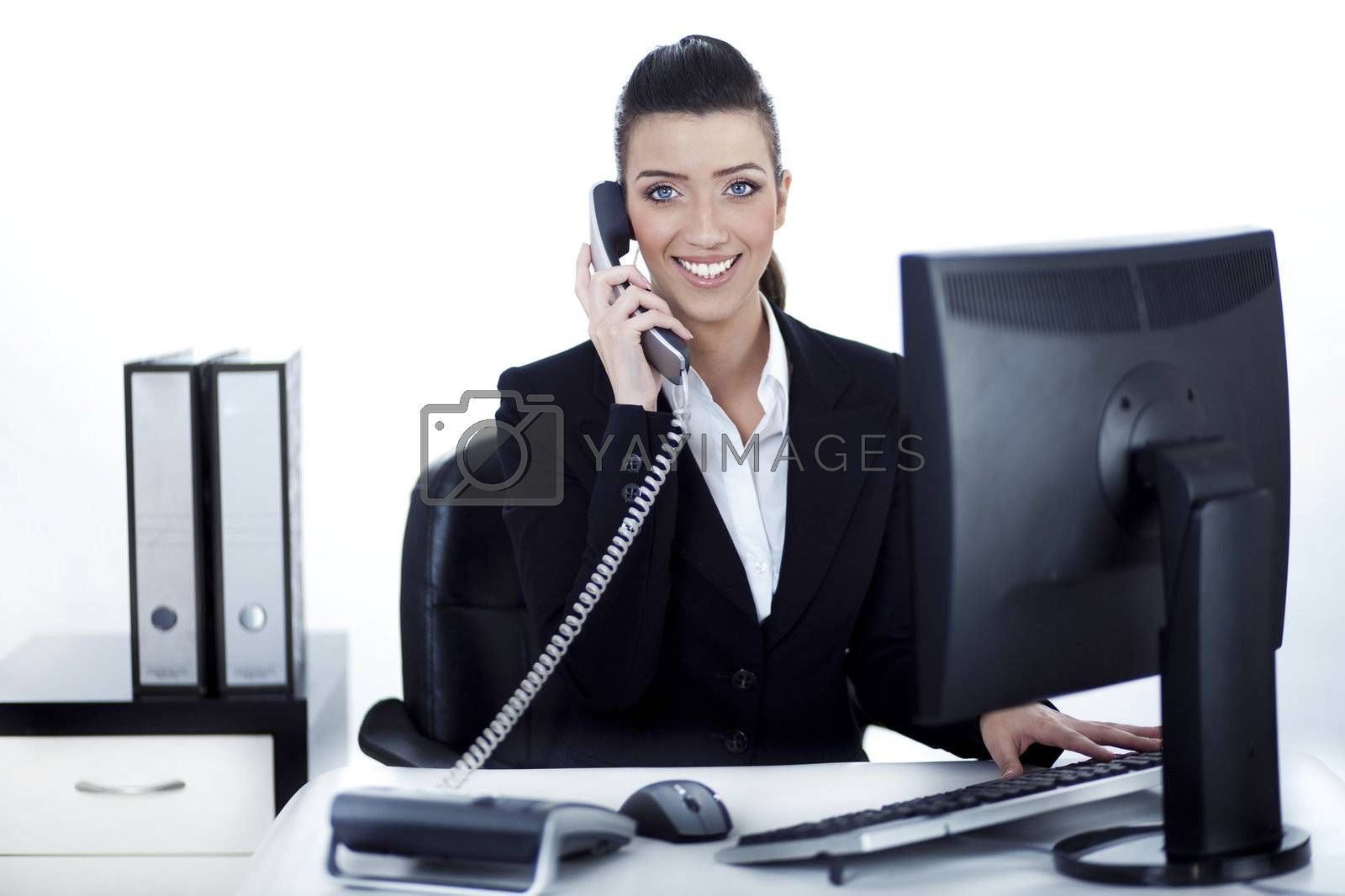 Royalty free image of Smiling woman busy over phone by get4net