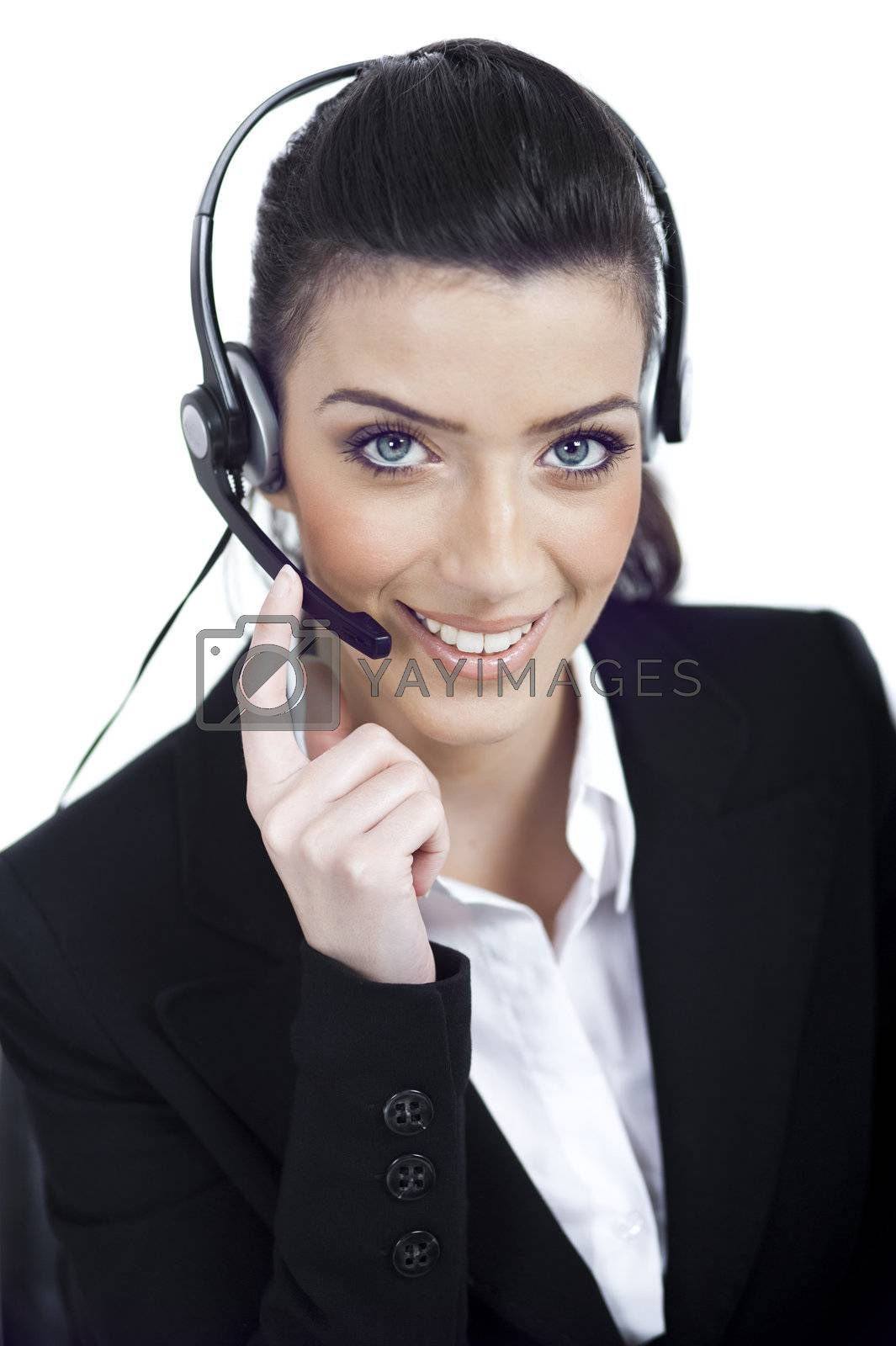 Royalty free image of Call center woman dealing with the customer wearing headset by get4net