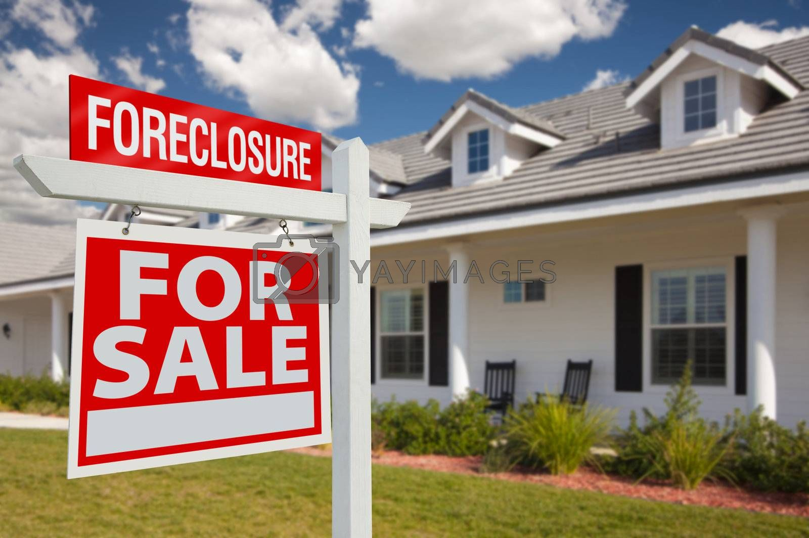 Royalty free image of Foreclosure Real Estate Sign and House - Left by Feverpitched