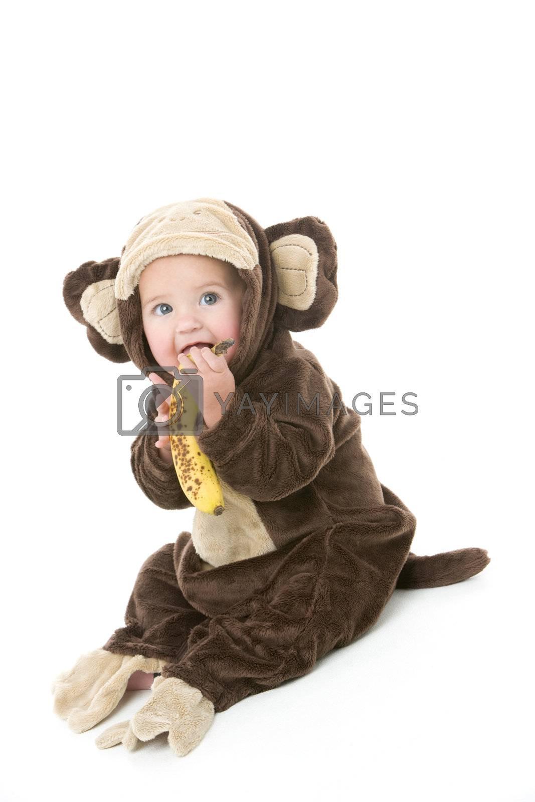 Baby in monkey costume holding banana