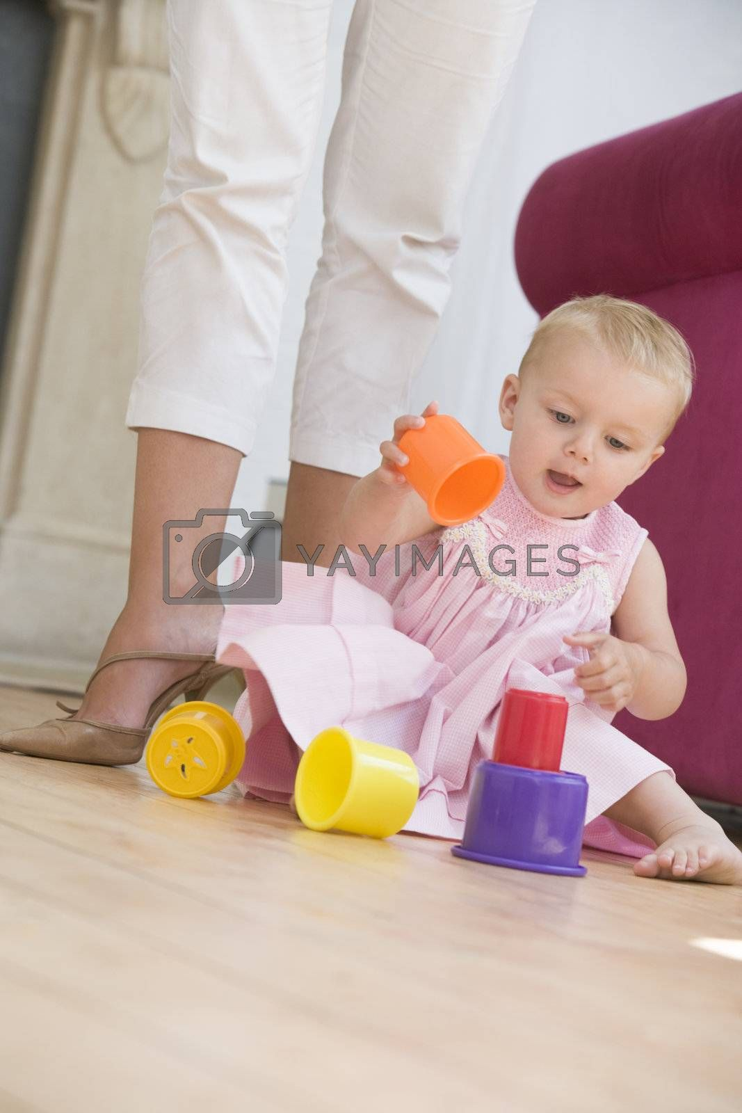 Mother in living room with baby playing