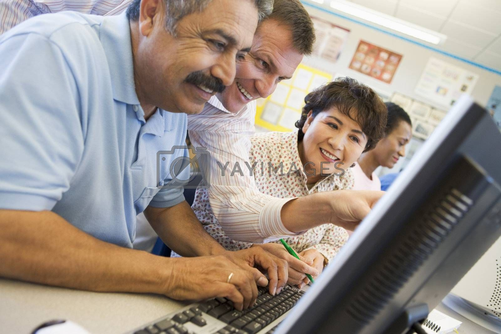Mature students learning computer skills by MonkeyBusiness