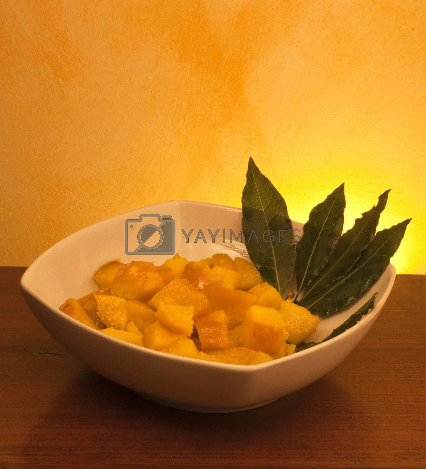 plate of boiled potatoes and seasoned background gradient
