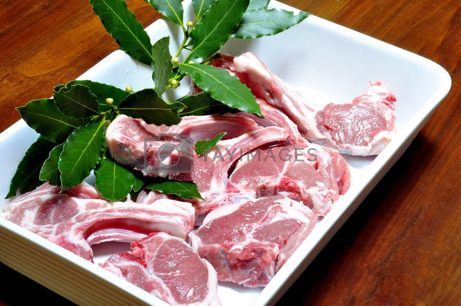 lamb chops with bay leaves in a baking dish