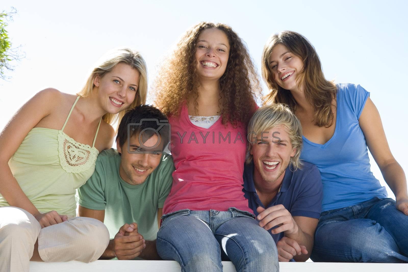 Five people on balcony smiling