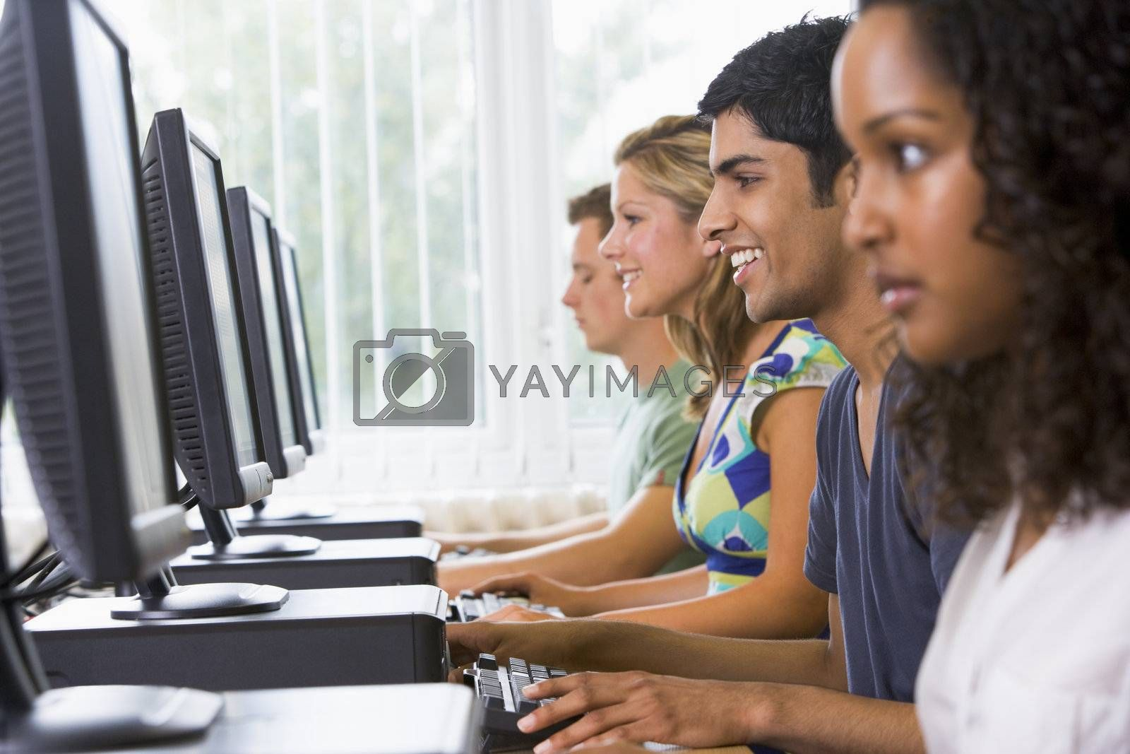 College students in a computer lab by MonkeyBusiness