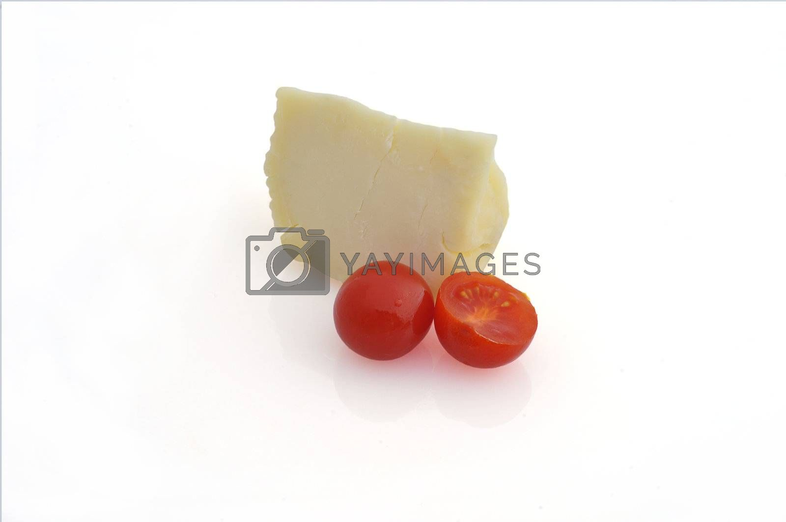 a piece of cheese and tomatoes on white background