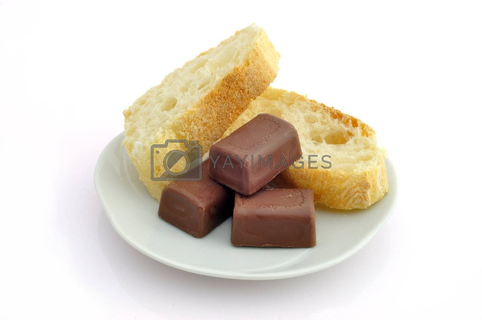 Bread and chocolate on a plate on a white background