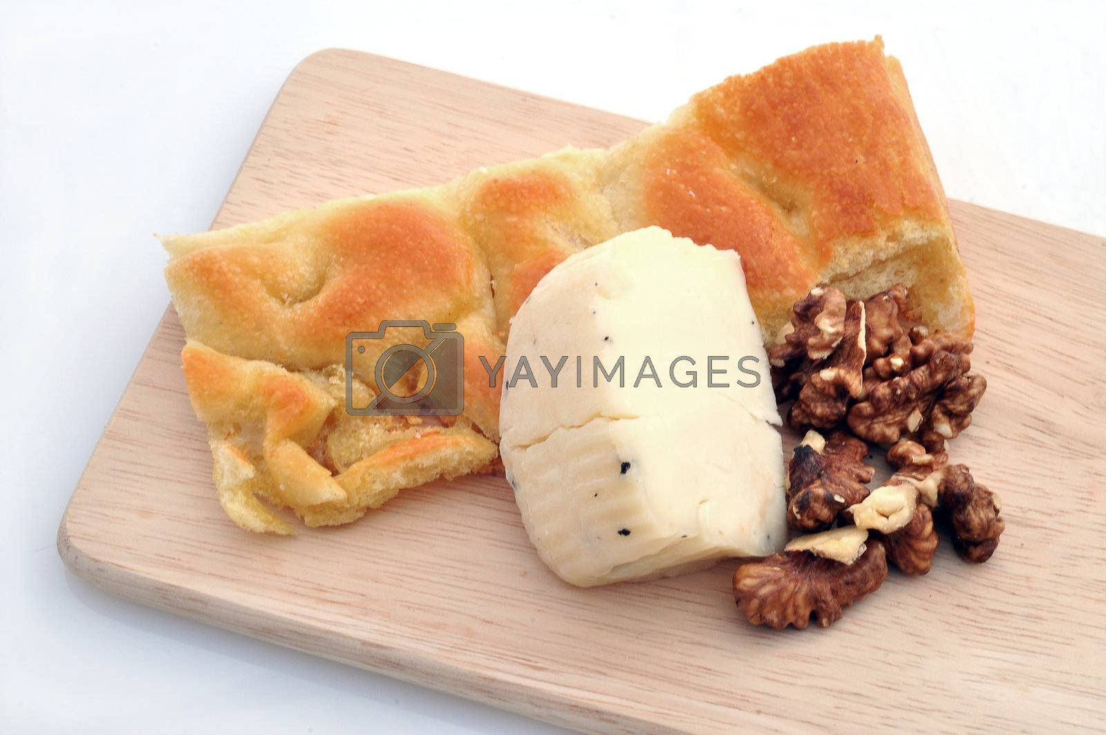 Focaccia, cheese and nuts on white background