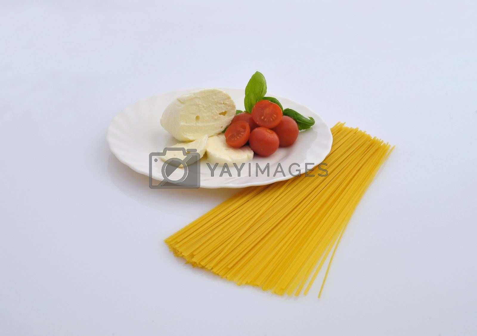 cheese, tomatoes and pasta on white background