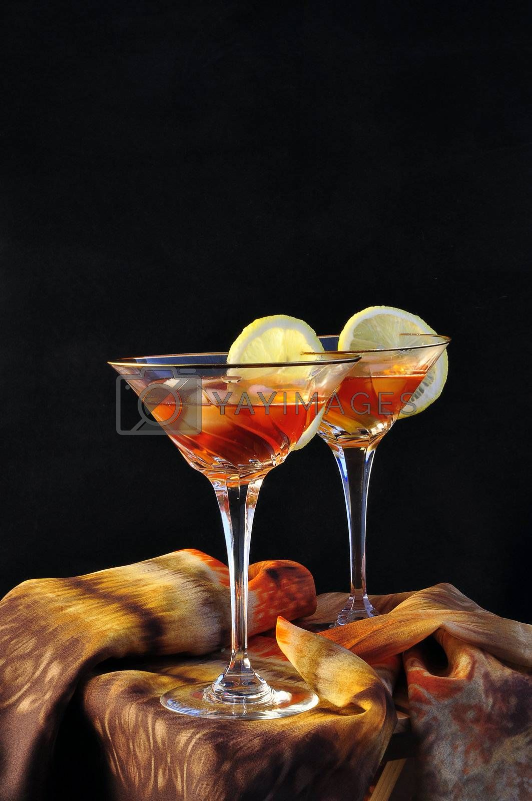 two cups with cocktail glass on a black background