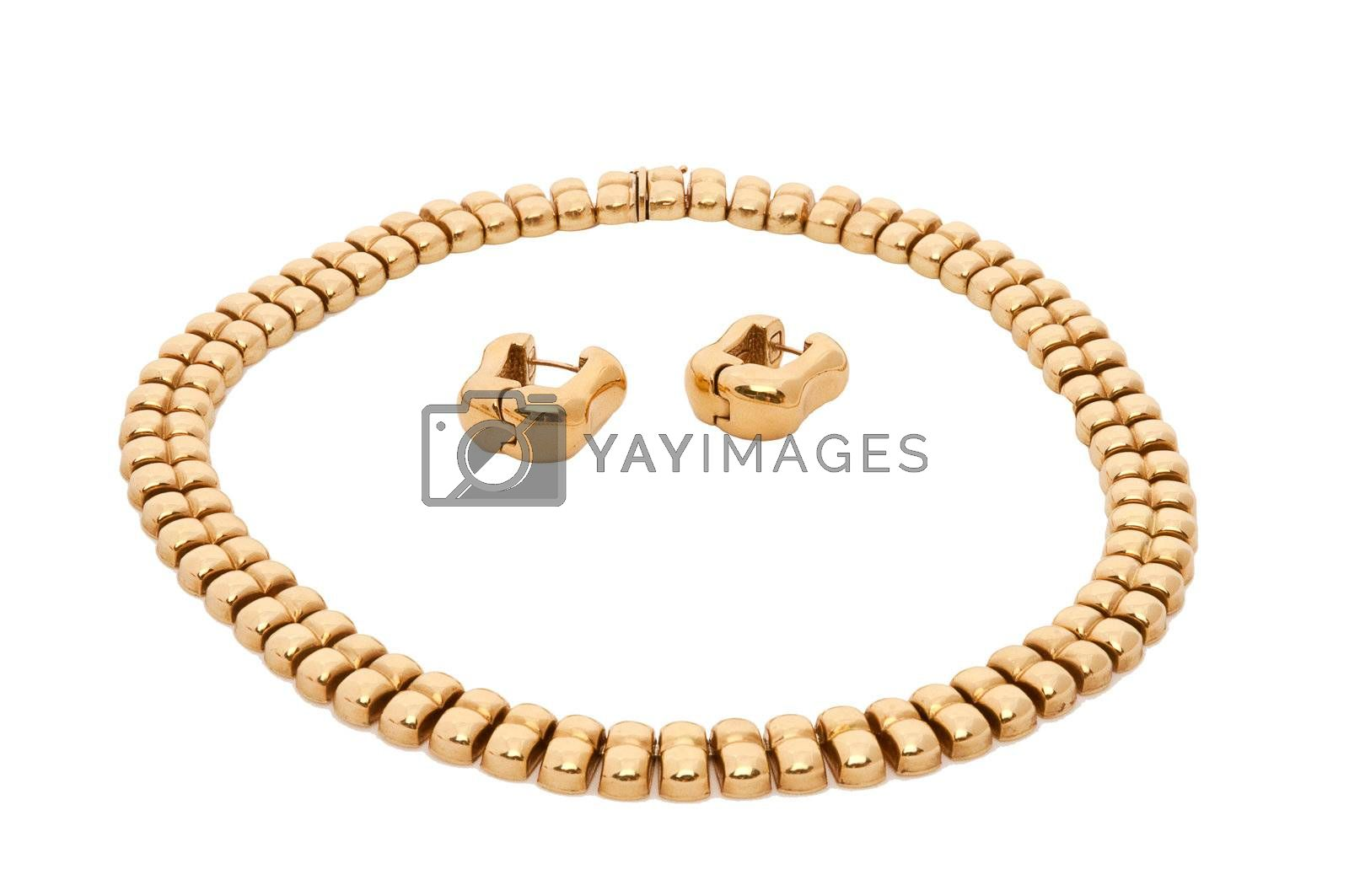 Sets consisting of gold necklace and earrings on a white background