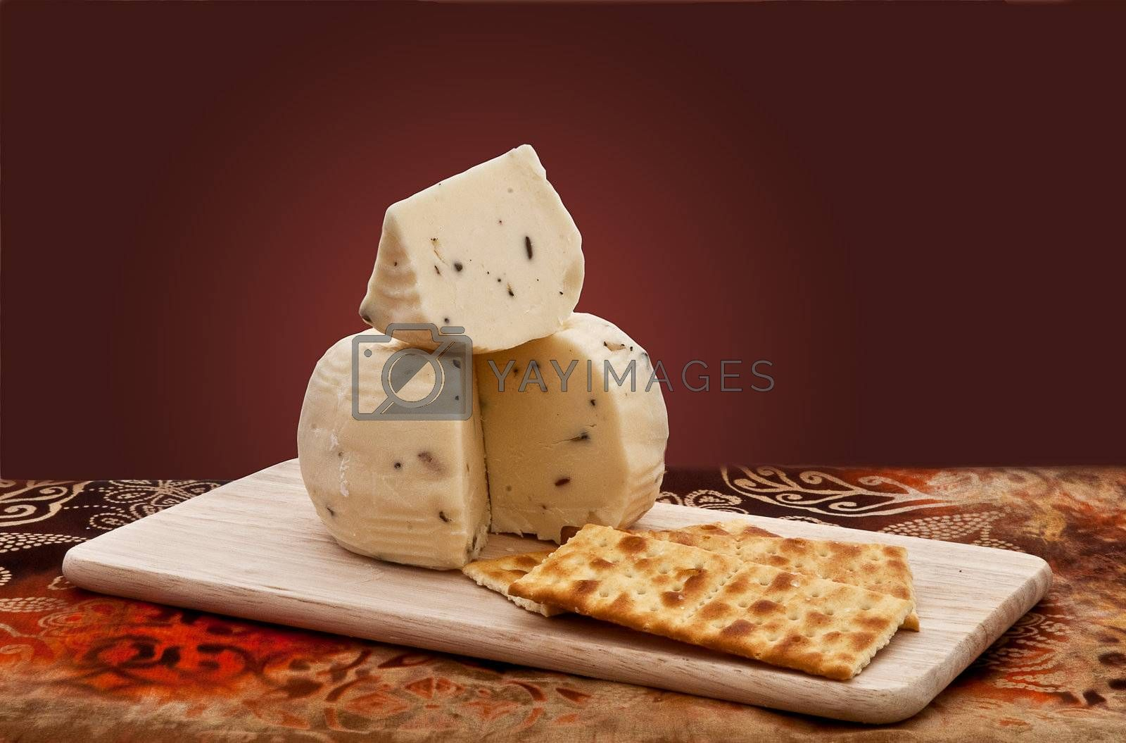 Truffle cheese and crackers on a cutting board