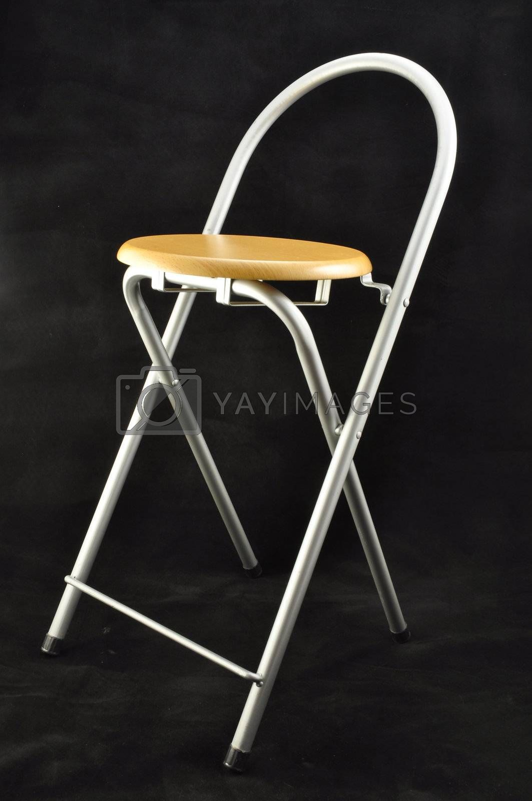 wooden folding stool chiaroe steel on a black background