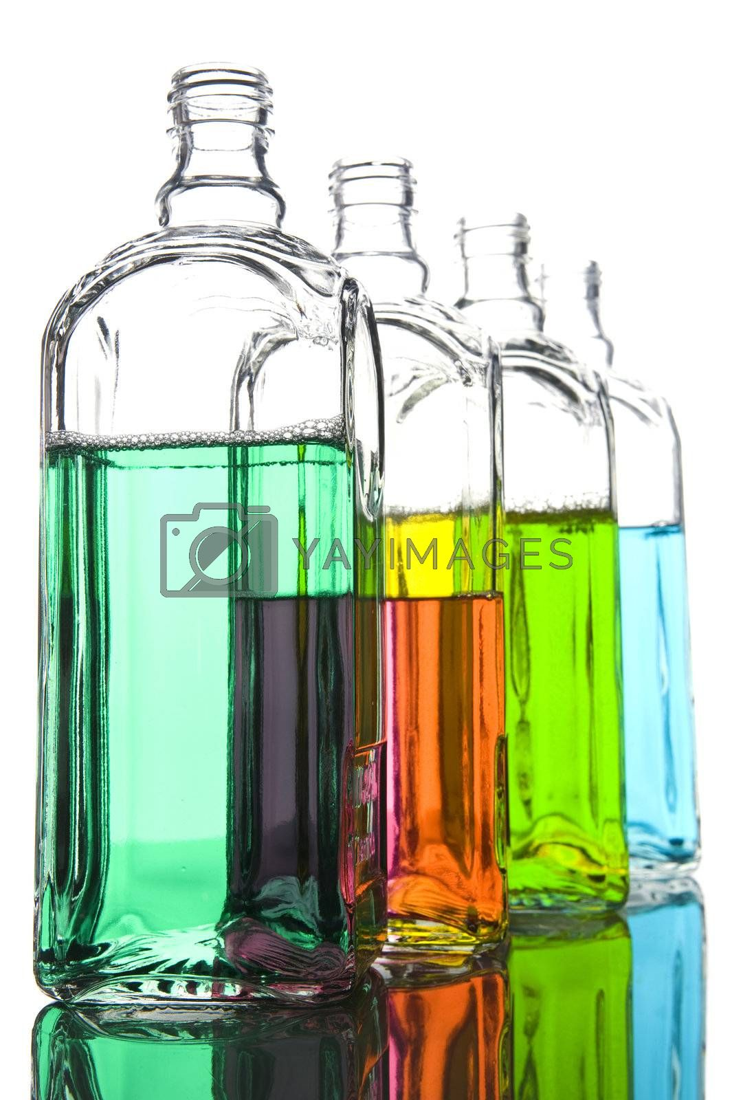 Royalty free image of Colored Bottle with liquid macro by Garry518