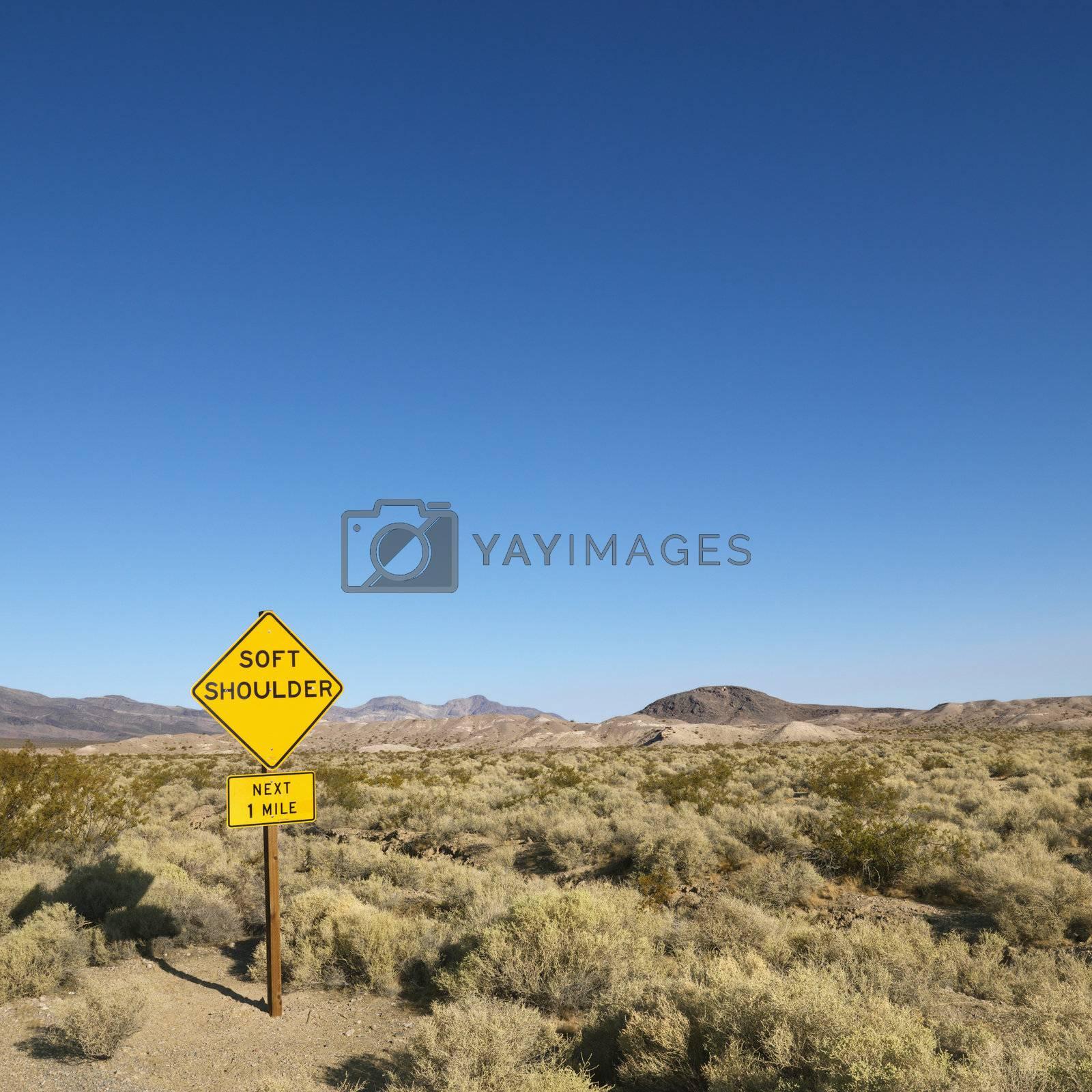 Sign in desert. by iofoto