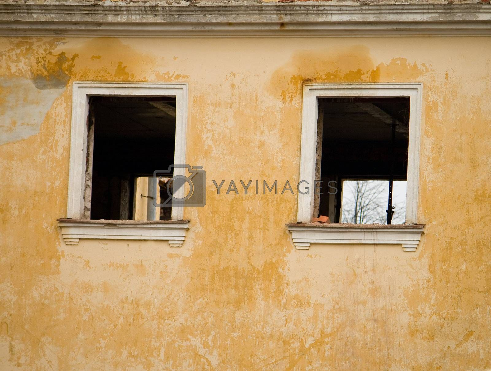 the wall of old building with windows