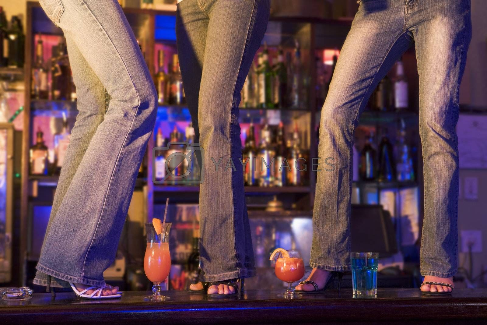 Young people dancing on a bar counter