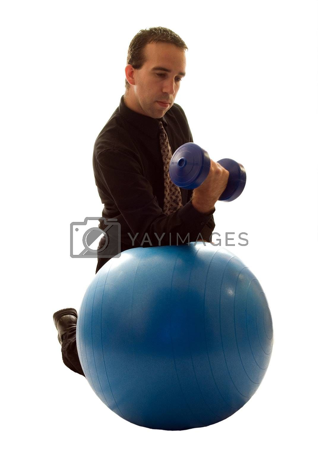 Businessman using a yoga ball and weights to help relieve stress