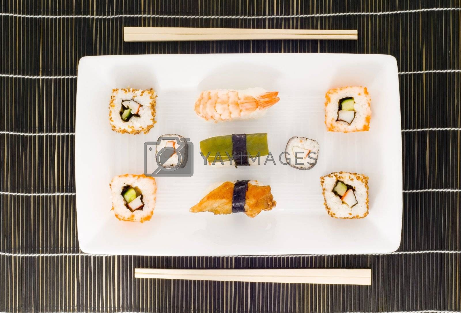 a plate with different kinds of sushi